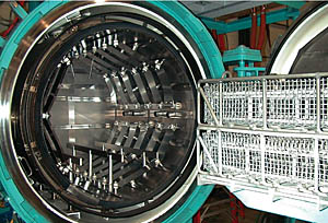 Baskets containing parts for heat treating ready for loading into furnace.